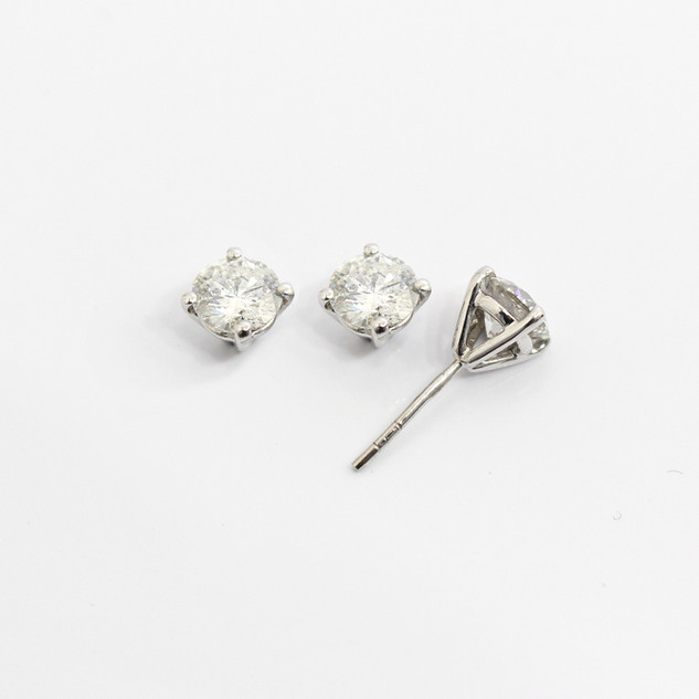 18ct white gold diamond stud earrings. The modern brilliant cut diamonds 0.70ct each, G/H colour, Si clarity. Total weight 1.40ct. £5,750.00