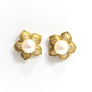 18ct yellow gold cultured pearl flower cluster earrings set with brilliant cut diamonds. The pearls measuring 6.5mm. £385.00