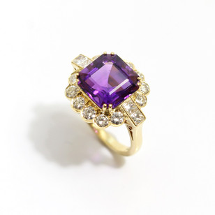 18ct all yellow gold amethyst and diamond ring.  Octagon shaped amethyst of fine colour at 4.11 ct, diamonds 1.02 ct. G colour, Vs clarity.  £3,850.00