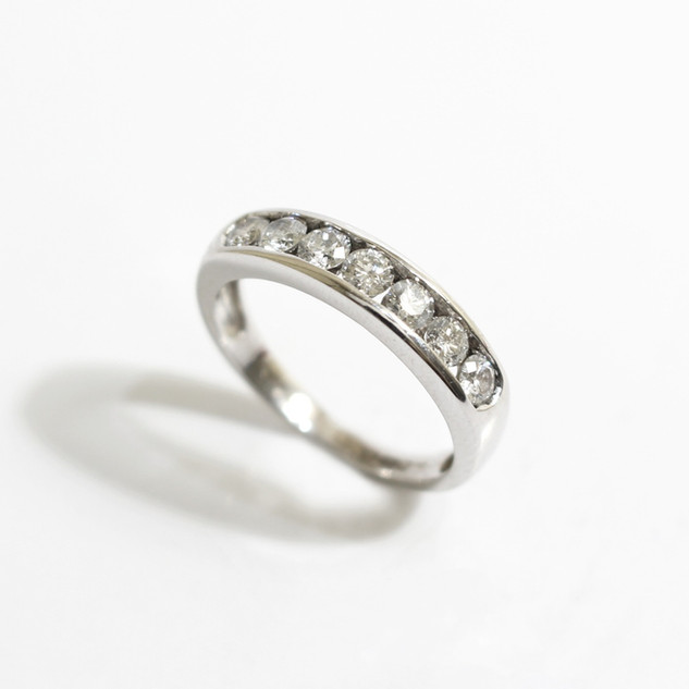 18ct white gold channel set seven stone diamond ring. The brilliant cut diamonds totalling 1ct, G colour. £1,250.00