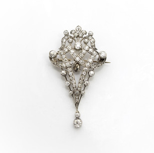 18ct gold and platinum diamond set brooch/ pendant. Total weight of old cut diamonds approximately 3cts. £3,750.00