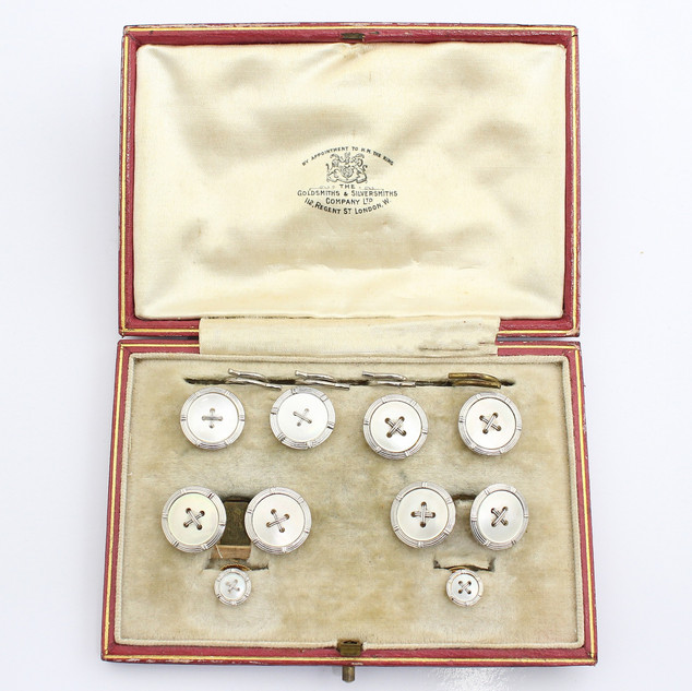 18ct yellow gold and platinum mother of pearl button dress set. The complete set comprising of cufflinks and studs. Cased. £1,250.00