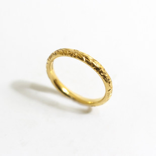A 22ct yellow gold hand carved ring. Grey-Harris & Co hallmark. Also available in platinum and 18ct gold. £675.00