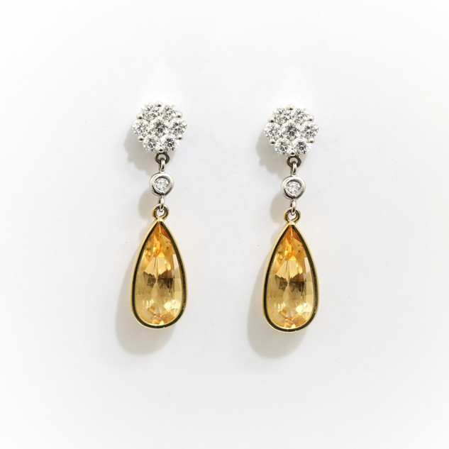 18ct yellow and white gold imperial topaz and diamond drop earrings. This is part of a pendant and earring set deisgned by Grey-Harris & Co. The topaz on each earring estimated 3cts, with diamonds totalling 0.75ct, G colour, Vs clarity. The pendant, topaz 4cts with diamonds totalling 0.70ct. £2,850.00 Complete set £5,200.00