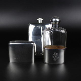 Silver and silver and glass hip flasks available.