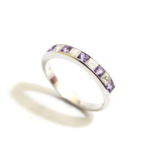 18ct white gold purple sapphire and diamond half eternity ring. Total sapphire weight 0.45ct, total diamond weight 0.33ct. £950.00
