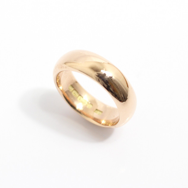 A 9ct rose gold chunky 'Court' profile wedding band. 7mm wide. Finger size T 1/2. £475.00
