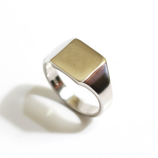 A heavy platinum square signet ring. Dated 2000. £1,250.00