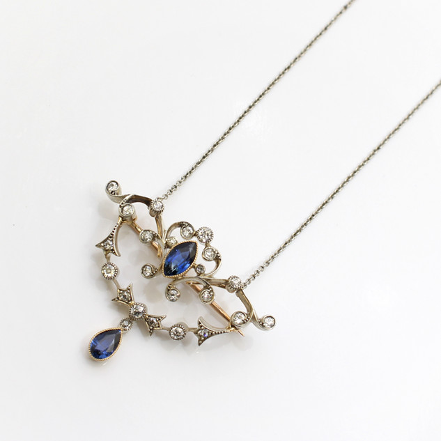 An Edwardian yellow gold and platinum fronted sapphire and diamond pendant with brooch fittings. £3,250.00