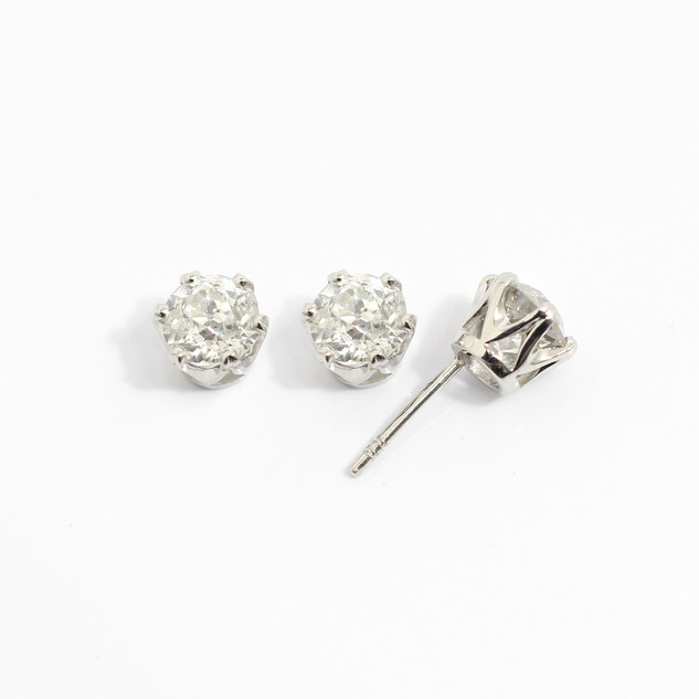 Platinum diamond stud earrings. The transitional cut diamonds totalling 2.36cts, Approximately H colour, pique clarity. £12,000.00