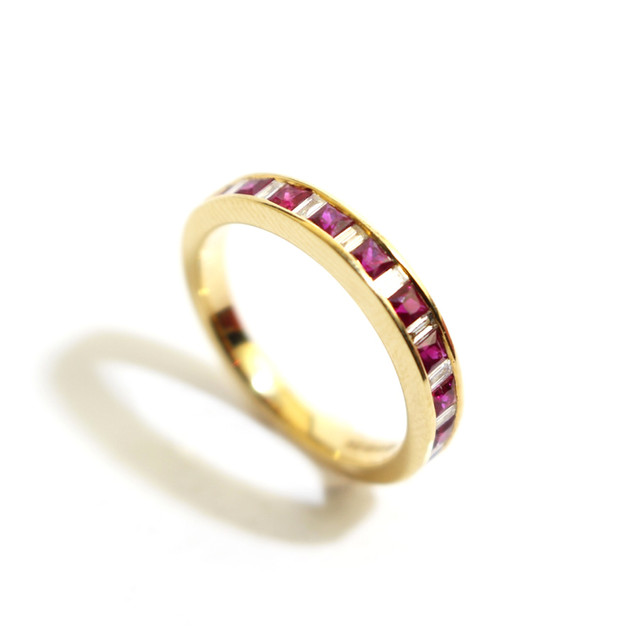 18ct yellow gold ruby and diamond half eternity ring. The square rubies totalling 0.27ct with baguette cut diamonds between, 0.17ct, G colour, Vs1 clarity. £1,450.00