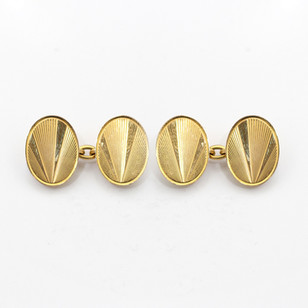 9ct yellow gold oval cufflinks with 'sunburst' engraving. £450.00