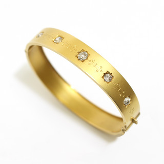 Late Victorian 18ct yellow gold frosted finish hinged bangle. The top section set with 5 graduated old cut diamonds with engraved decoration. Circa 1880.  £2,250.00