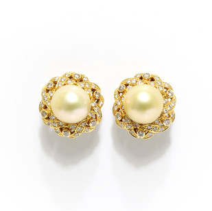 18ct gold South Sea pearl earrings with a diamond and yellow gold surround. The light golden coloured pearls measuring 11.5mm. Part of a ring and earring set. Complete price £5,500.00