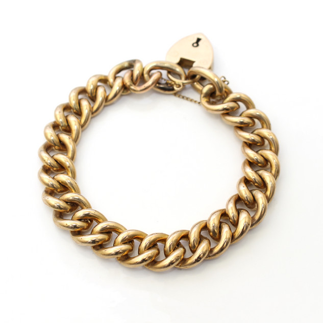 9ct yellow gold curb link bracelet with heart padlock. £600.00