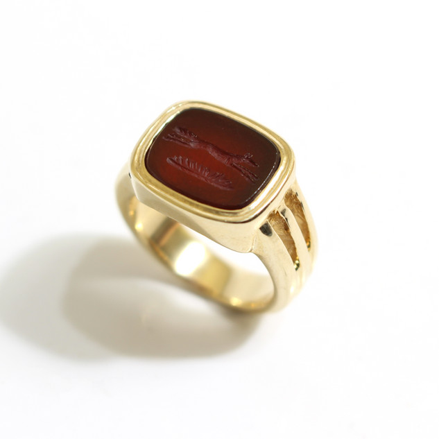 9ct gold crested cornelian signet ring with ribbed shoulders. £650.00