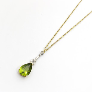 18ct yellow and white gold peridot and diamond drop pendant. Part of a pendant and earring set. The peridots in the earrings 8cts each, the peridot in the pendant 11cts. The complete cased set £5,250.00