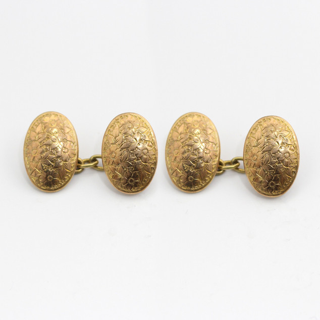 9ct yellow gold, oval and domed cufflinks with floral engraving. £375.00