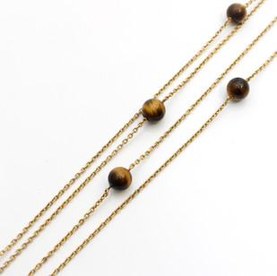 15ct yellow gold double length chain necklace with tigers eye beads. Total length 57 inches. £950.00