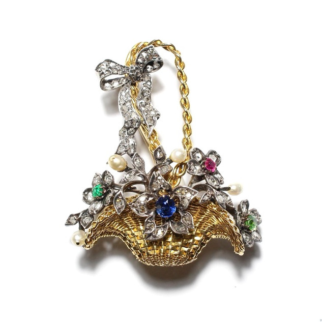 18ct yellow gold and platinum basket of flowers brooch. Set with sapphire, emerald, ruby, peridot, pearl and rose cut diamonds. Circa 1910 In Grey-Harris & Co fitted case. £6,000.00