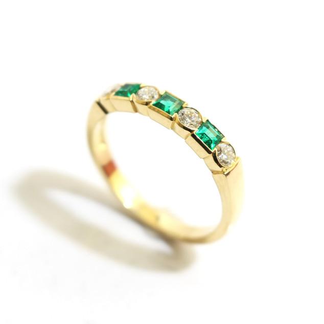 18ct yellow gold Columbian emerald, 0.29ct and diamond, 0.29ct, G colour, Vs1 clarity half eternity ring. £2,750.00