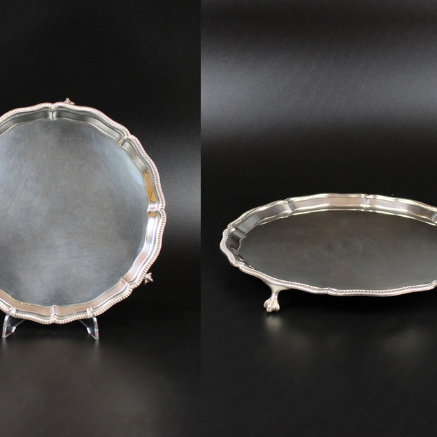 Mappin and Webb  Sheffield 1946 Fine quality shaped straight gadroon boarder with three claw and ball feet. 8 inches  £475.00