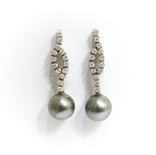 18ct white gold Tahitian pearl and diamond drop earrings. The grey pearls measuring 12mm, suspended below brilliant cut diamonds features. £2,750.00