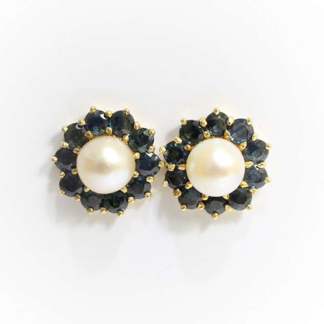 9ct yellow gold pearl and sapphire cluster stud earrings. The cultured pearls measuring 8mm. £375.00
