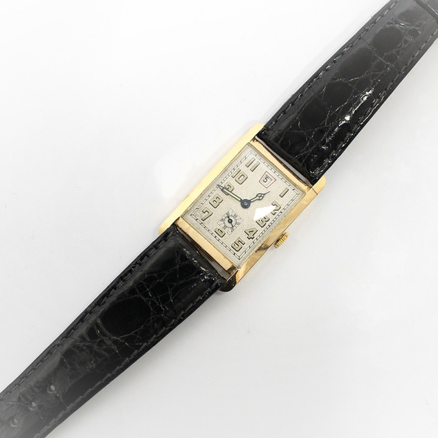 18ct yellow gold rectangular dial wrist watch. Swiss movement with English hallmark for 1931. Fully serviced. £1,650.00