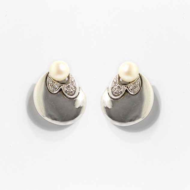 18ct white gold pearl and diamond  clip earrings. Total diamond weight 0.23ct. £2,850.00