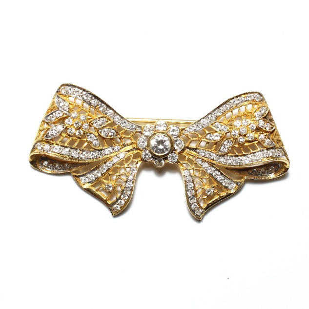 18ct yellow gold diamond set bow brooch. In a Grey-Harris & Co fitted case. £2,750.00