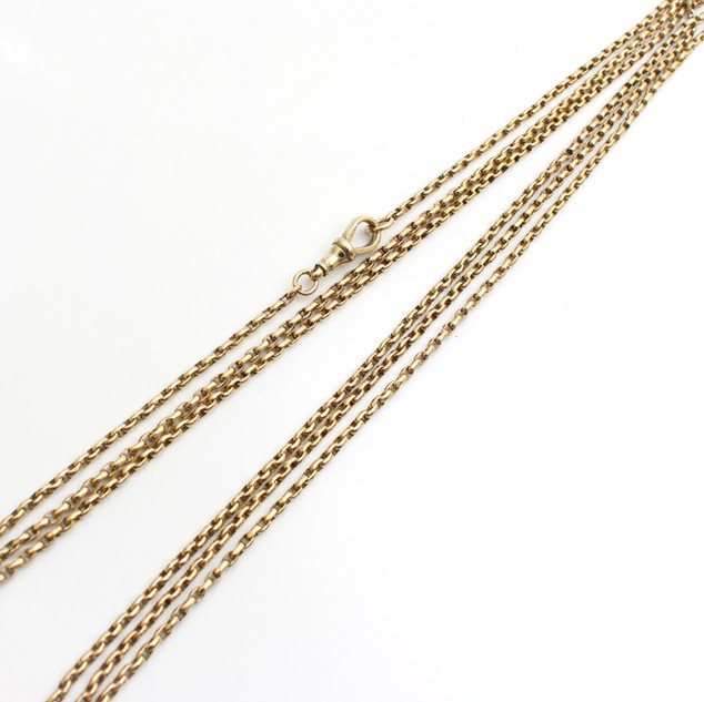 "A 9ct gold Victorian muff chain in very fine condition. Total length 54"". £1,450.00"