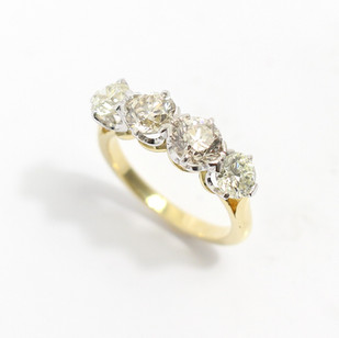 Platinum and 18ct yellow gold mounted four stone half hoop ring. The four well matched circular modern brilliant cut diamonds, 2 x 0.75ct and 2 x 0.50ct. Tinted in colour, estimated M colour, Vs2/Si clarity, total diamond weight 2.50cts. High quality hand made platinum coronet claw setting to a 18ct yellow gold undergallery and shank. Hand made setting, Hallmarked Grey-Harris & Co. £11,000.00