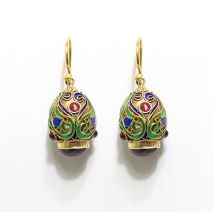 15ct gold and enamel drop earrings set with almandine garnets. £1,850.00