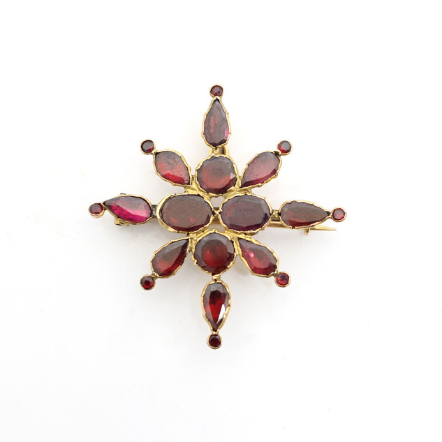 A Victorian gold mounted garnet brooch. £400.00