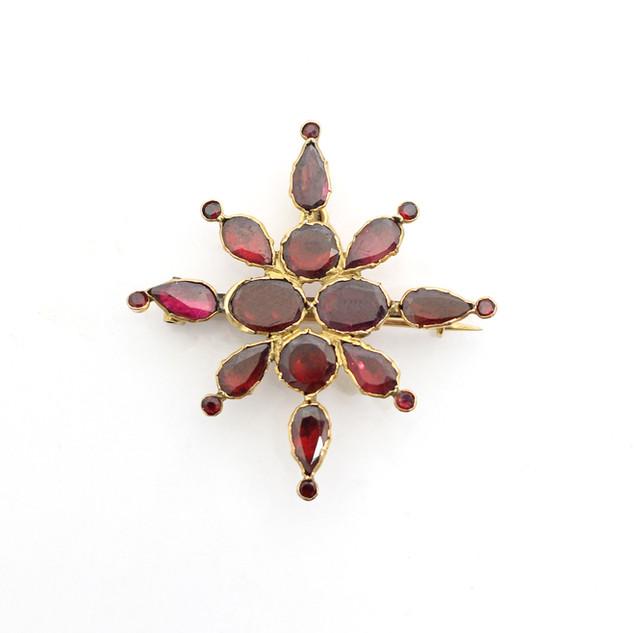 A Victorian gold mounted garnet brooch. £400.00