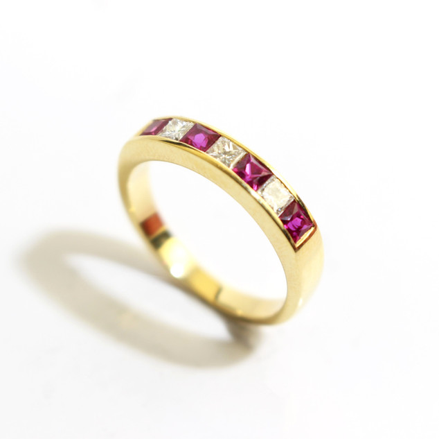 18ct yellow gold ruby and diamond channel set half eternity ring. Total ruby weight 0.52ct, diamond weight 0.30ct, G colour, Vs1 clarity. £1,750.00