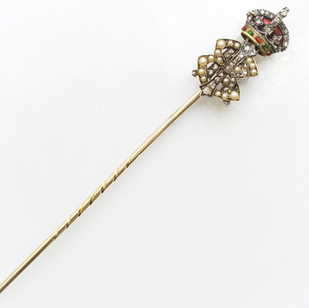 Edward VII stick pin. The crown adorned with old cut diamonds, tiny cabochon rubies and emeralds with red enamel  The pin completed with seed pearls and old cut diamonds. Cased. £2,250.00