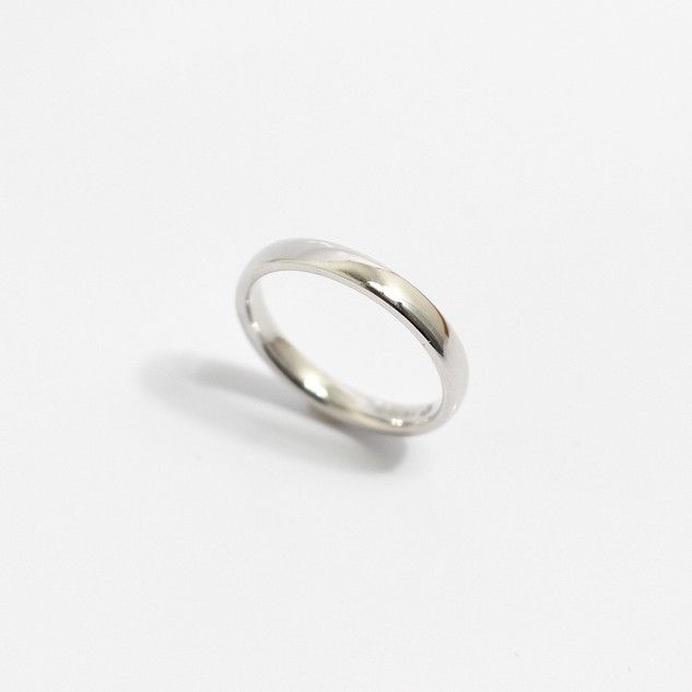 A 2mm platinum heavy weight 'Court' profile wedding band. Grey-Harris & Co hallmark. Most wedding rings are priced by weight. This example is a size M. £450.00 Please enquire for alternative price and sizing.
