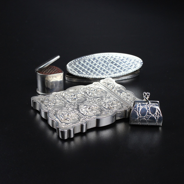We have a range of silver cases, including toothpick boxes, nutmeg graters, card cases and pill boxes. Some of which are photgraphed here.  1. Silver nutmeg grater unmarked. Circa 1680  £485.00 2. Unmarked toothpick case with mirror lid inside. Likely to be Continental, C1800. 3 ½ inches. £ 485.00  3. Indian 19th century card case. Well chasted and in fine condition. Shiva or Kali dancing. 3 oz £220.00 4. Modern pill case in form of crocodile handbag. 1 ¼ inches.  £145.00