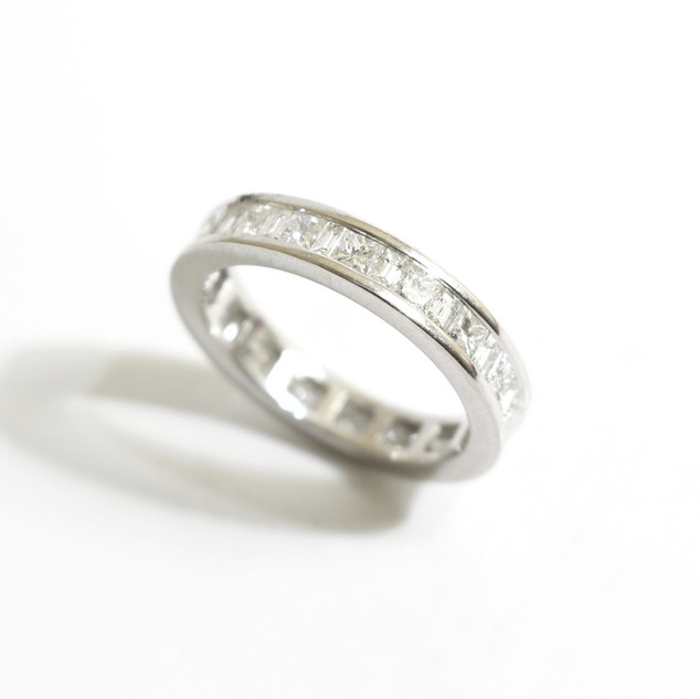 Platinum and diamond full eternity ring. Total diamond weight 1.84 ct. Alternating princess and baguette cut diamonds. Channel set.  £5,250.00