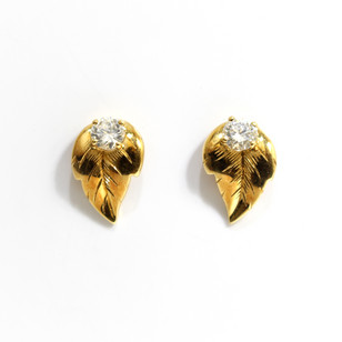 18ct gold diamond set leaf earrings. Diamond weight totalling 0.40ct, G colour, Vs1 clarity. £1,850.00