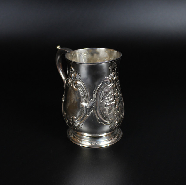 Pint Mug 1790  By Hester Bateman  Victorian floral chasing with vacant cartouche Weight – 9 ½ oz £475