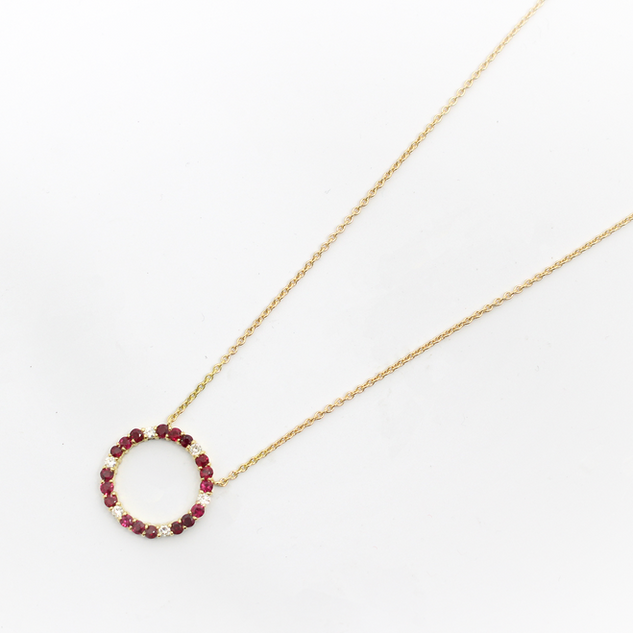 18ct yellow gold, ruby amd diamond circlet pendant. Total ruby weight 1.65ct, total diamond weight 0.60ct. £2,750.00