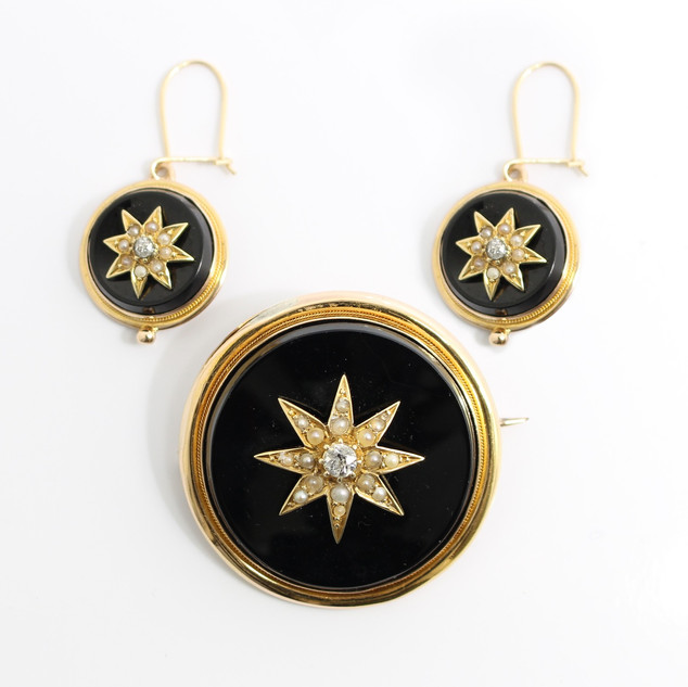 A cased set of Victorian onyx, diamond and seed pearl brooch and earrings. Mounted in 15ct gold. Complete set £850.00