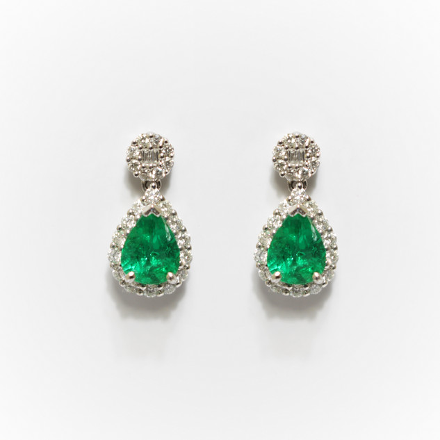 18ct white gold emerald and diamond drop earrings. The emeralds 0.77cts with border of brilliant cut diamonds suspended below a diamond cluster, 0.43ct. £3,250.00