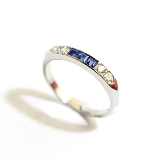 A platinum sapphire and diamond half eternity ring. The three square cut sapphire totalling 0.33ct. Total weight of brilliant cut diamonds 0.26ct, G colour, Vs1 clarity. £1,600.00