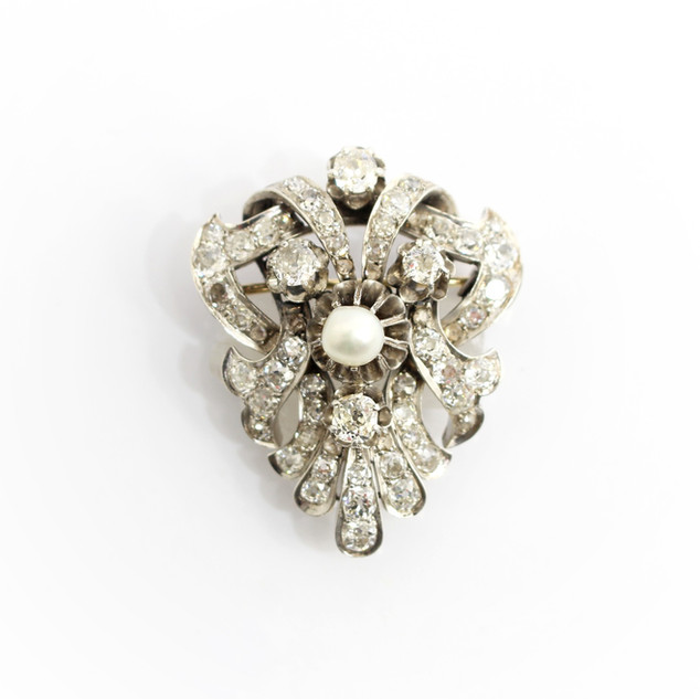 18ct gold and platinum natural pearl and diamond brooch. The total weight of old cut diamonds approximately 6cts. £4,750.00