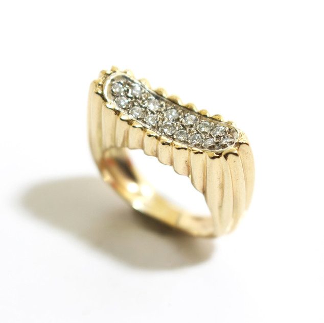 A 1970's 18ct yellow gold and diamond set dress ring. £1,450.00