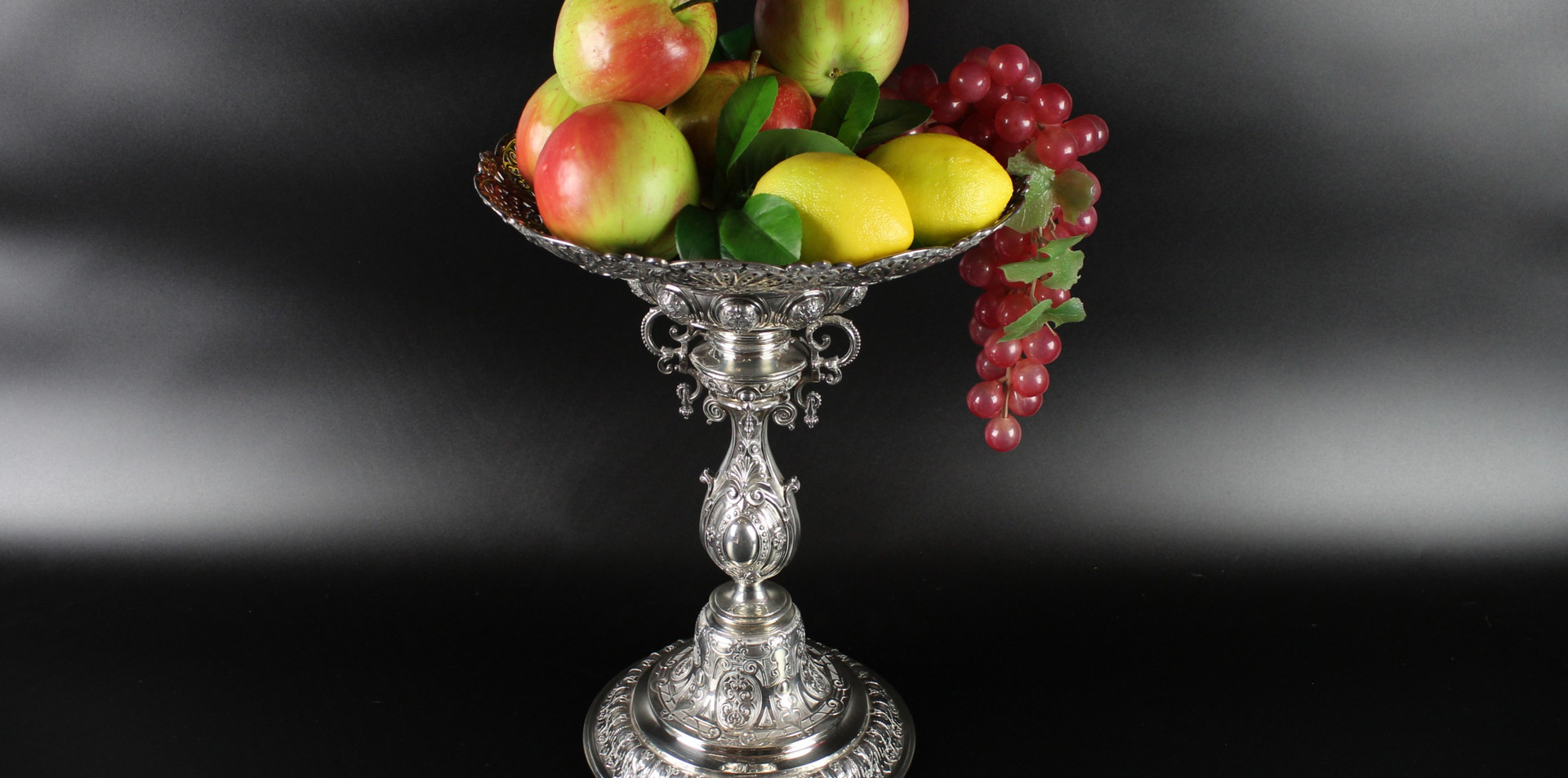 Fruit stand / centre piece Indian fan style / Peacock plume style with bell foot bulbous stem and pierced oval detachable dish.   Robert Garrard II ( -1881) 1875 14 inches height 67 oz £5,500.00